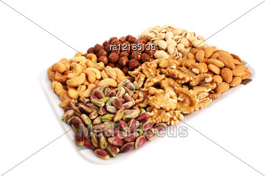 Different Nuts Isolated On White Background. Stock Photo