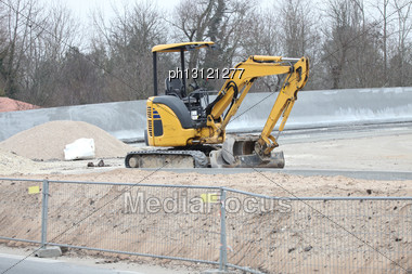 Digger On Construction Site Stock Photo