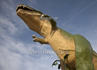 Dinasaur Statue Drumheller Large With Blue Sky Stock Photo
