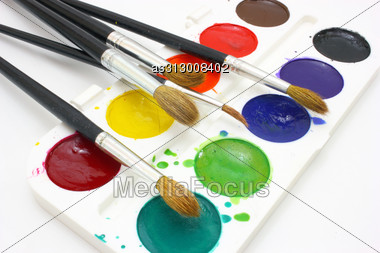 Dirty Watercolor Paints Set With Brushes After Using Stock Photo