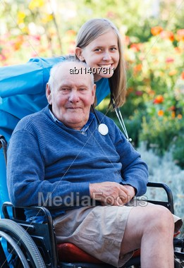Disabled Old Man Being Pleased With The Quality Of The Homecare Service Stock Photo