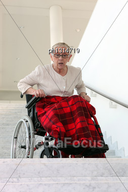Disabled Woman In Front Of Stairs Stock Photo