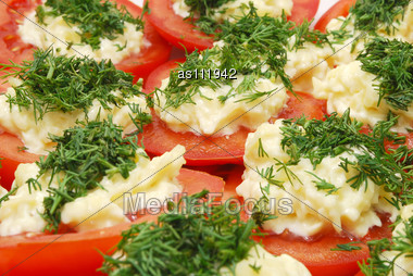 Dish Of Red Tomato Slices With Horseradish And Chopped Parsley Stock Photo