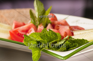 Dish Of Various Vegetables Such As Tomatoes, Cucumbers And Mint Stock Photo