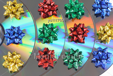 Disks With Multicolored Bows Lay Abreast Stock Photo