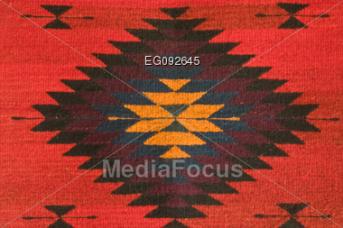 Displays A Mexican Tapestry Embroidered With A Diamond Shape Stock Photo