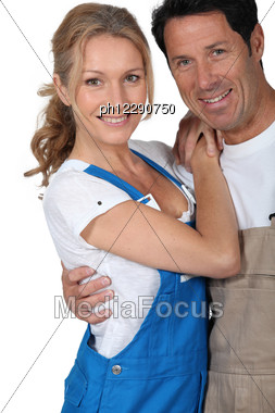 DIY Couple In Overalls Stock Photo