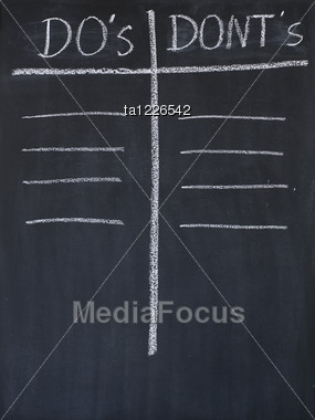 Do's And Dont's List Drawn On A Blackboard Stock Photo