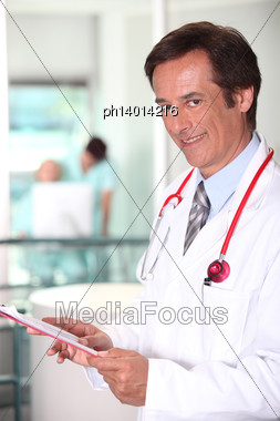 Doctor Checking Clip-board Stock Photo