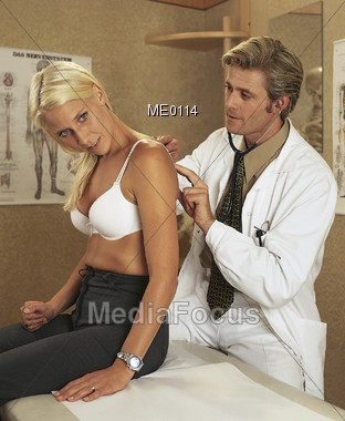 Doctor Examining Patient Stock Photo