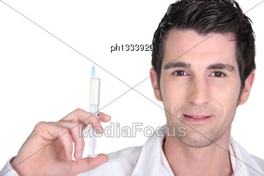 Doctor Holding Up An Injection Stock Photo
