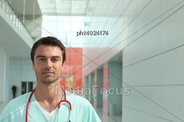 Doctor In Hospital Corridor Stock Photo