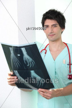 Doctor Looking At An X-ray Stock Photo
