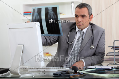 Doctor Looking At X Stock Photo