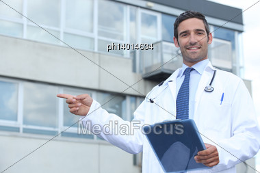 Doctor Pointing Outside Stock Photo