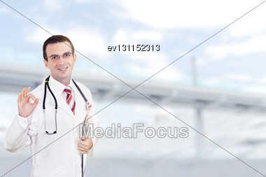 Doctor Stand Near The Hospital Main Entrance. Outdoor Stock Photo