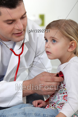 Doctor With A Little Girl Stock Photo
