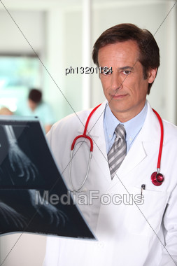 Doctor With X-ray Image Of Hand Stock Photo
