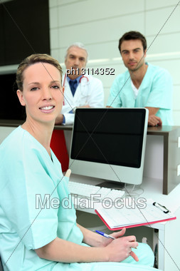 Doctors In Hospital Reception Stock Photo