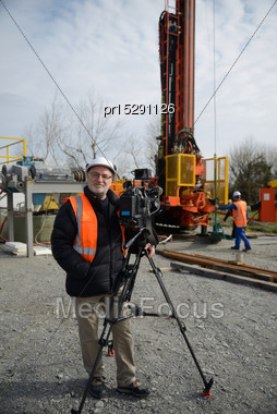 Documentary Filmmaker Poses With His Camera On Location Stock Photo