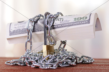 Dollars Are Closed On The Padlock And A Chain Stock Photo