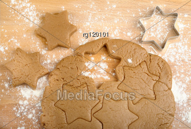 Dough And Cookie Cutter On A Wooden Background Stock Photo