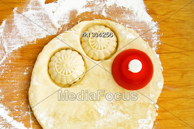Dough For Cookies With Red Tins Strewn With Flour On Board Stock Photo