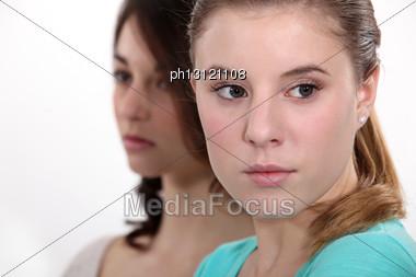 Downcast Young Women Stock Photo