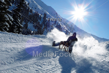 Downhill on Wooden Sleigh Stock Photo