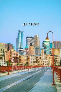 Downtown Minneapolis, Minnesota At Night Time As Seen From The Famous Stone Arch Bridge Stock Photo