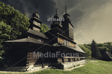 Dramatic Landscape With Orthodox Church Under Mood Skies Stock Photo