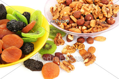 Dried Fruits And Nuts In Vases Isolated On White Background. Stock Photo