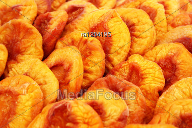 Dried Peaches Close Up Picture. Stock Photo