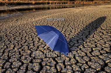 Dried Up River Bed And Umbrella Stock Photo