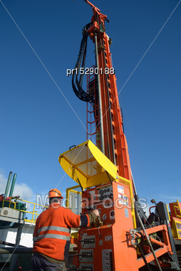 Drilling Crewman Operates A New Rig Drilling Near Greymouth, South Island, New Zealand Stock Photo