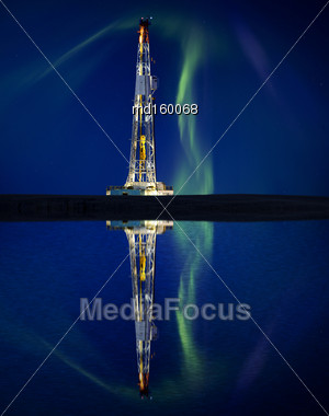 Drilling Rig And Lake Reflection Northern Lights Aurora Stock Photo