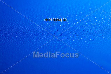 Drops Of Liquid (water) On Blue Background Stock Photo