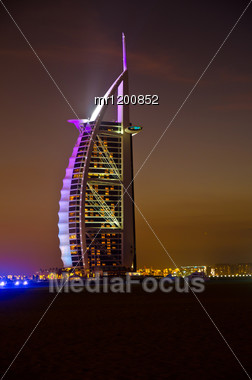 DUBAI - JANUARY 4: Burj Al Arab Hotel, One Of The Few 7 Stars Hotel In The World And One Of The Most Recognized Luxury Symbol At Night On JANUARY 4, 2012 In Dubai, United Arab Emirates Stock Photo