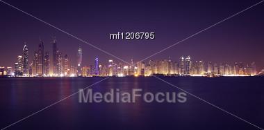 Dubai Marina In The Night. Panoramic View From Gulf Stock Photo