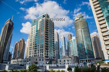DUBAI, UAE - NOVEMBER 13: Dubai Downtown Night Scene With City Lights, Luxury New High Tech Town In Middle East, United Arab Emirates Architecture. Dubai Marina Cityscape, UAE Stock Photo