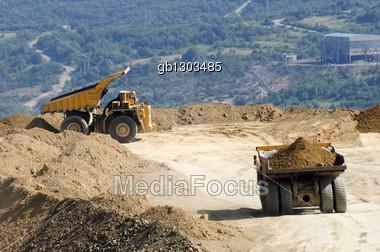 Dump trucks in the quarry Stock Photo