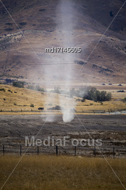 Dust Devil New Zealand Tornado Twisting In Dirt Stock Photo