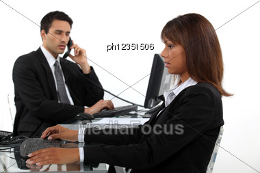 Dynamic Business Duo Stock Photo