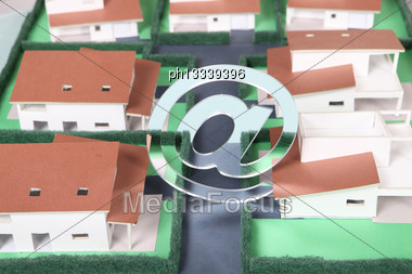 E-mail Symbol Above Model Housing Stock Photo