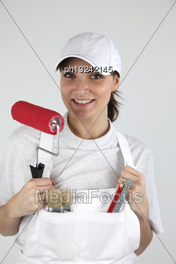 Eager Female Decorator Stock Photo