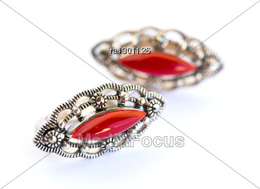 Earrings With Red Stones Isolated On White Background. Stock Photo