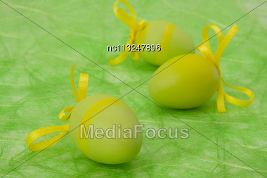 Easter Background. Easter Eggs And Flowers On Green Sisal Background, Selective DOF Stock Photo