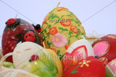 Easter colorful candle eggs nest. Stock Photo