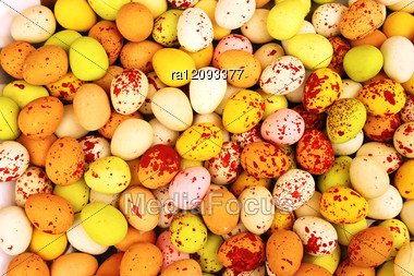 Easter Colorful Candy Eggs Closeup Picture. Stock Photo