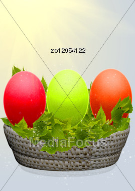 Easter Eggs In A Basket With Birch Branches Stock Photo